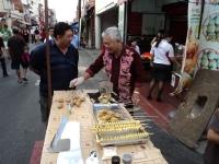 An uncle selling fried potato at Jonker Street